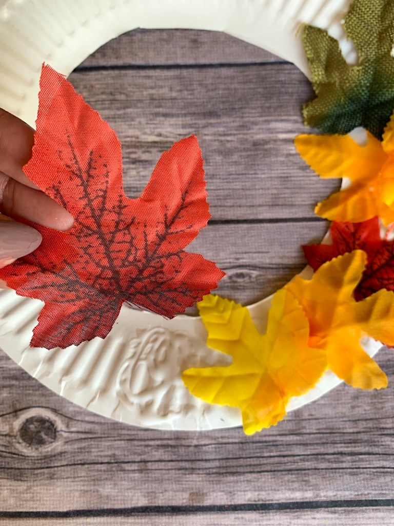 Glue assorted fall leaves onto paper plate wreath