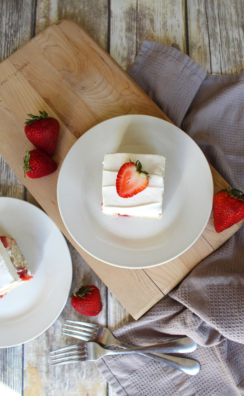 Strawberry poke cake recipe with fresh strawberries and whipped topping