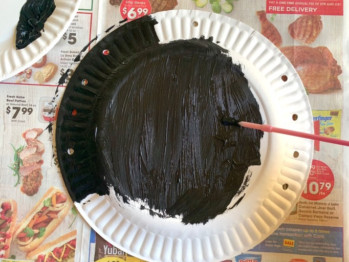 Paint the paper plate spider black