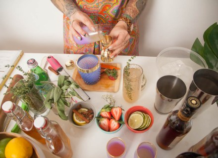 An overhead photo of Natalie Jacob making a cocktail