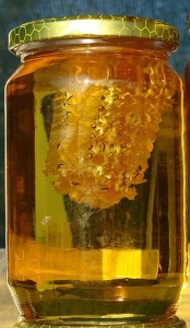 Chunk honey in a jar.