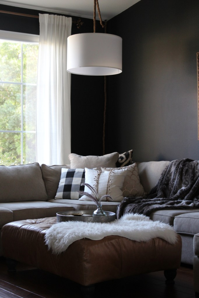 A Moody Fall Home Tour woth pomegranates and black and white buffalo check pillow