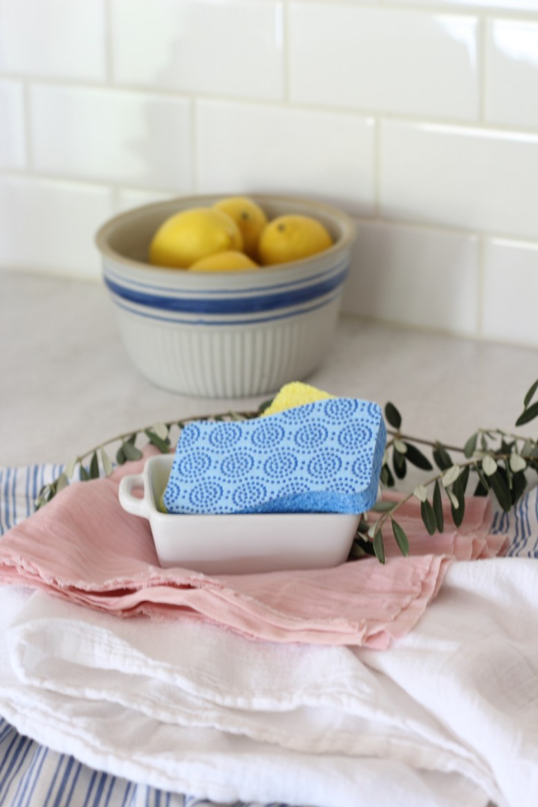 Use a soap tray be the kitchen sink to make dishes easier and corral clutter