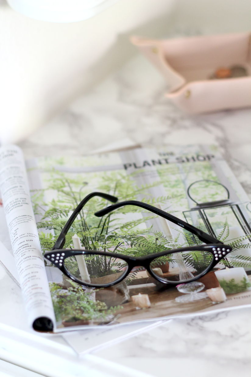 Spring greenery and reading glasses