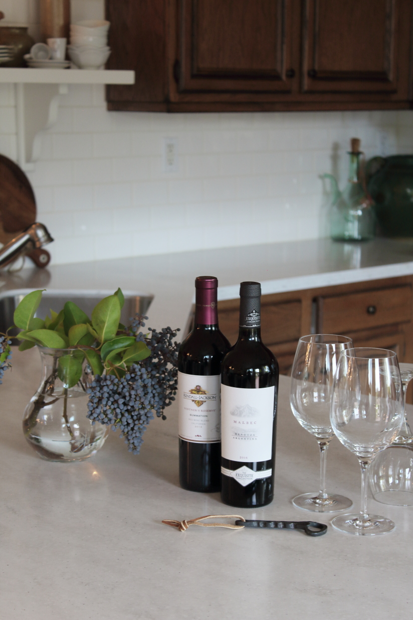 Bottle of wine with wine glasses