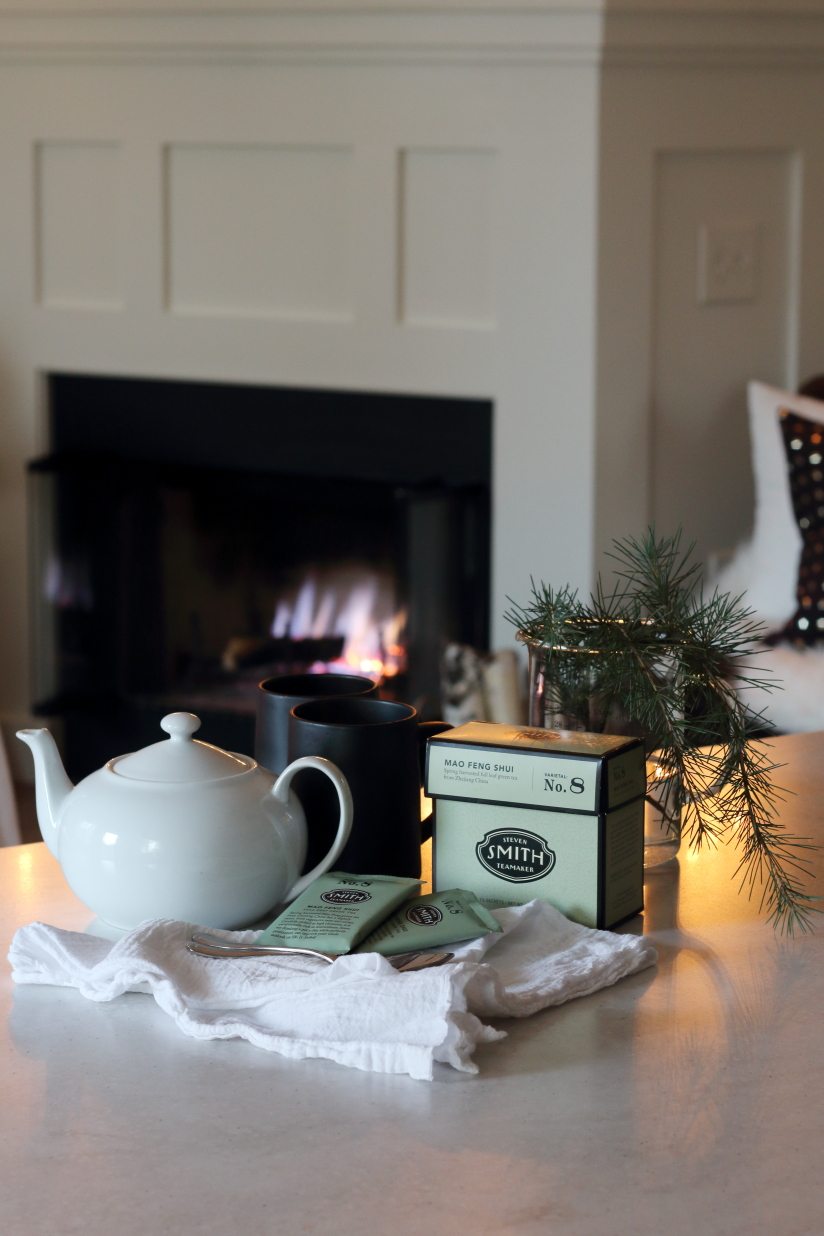 tea in front of the fireplace