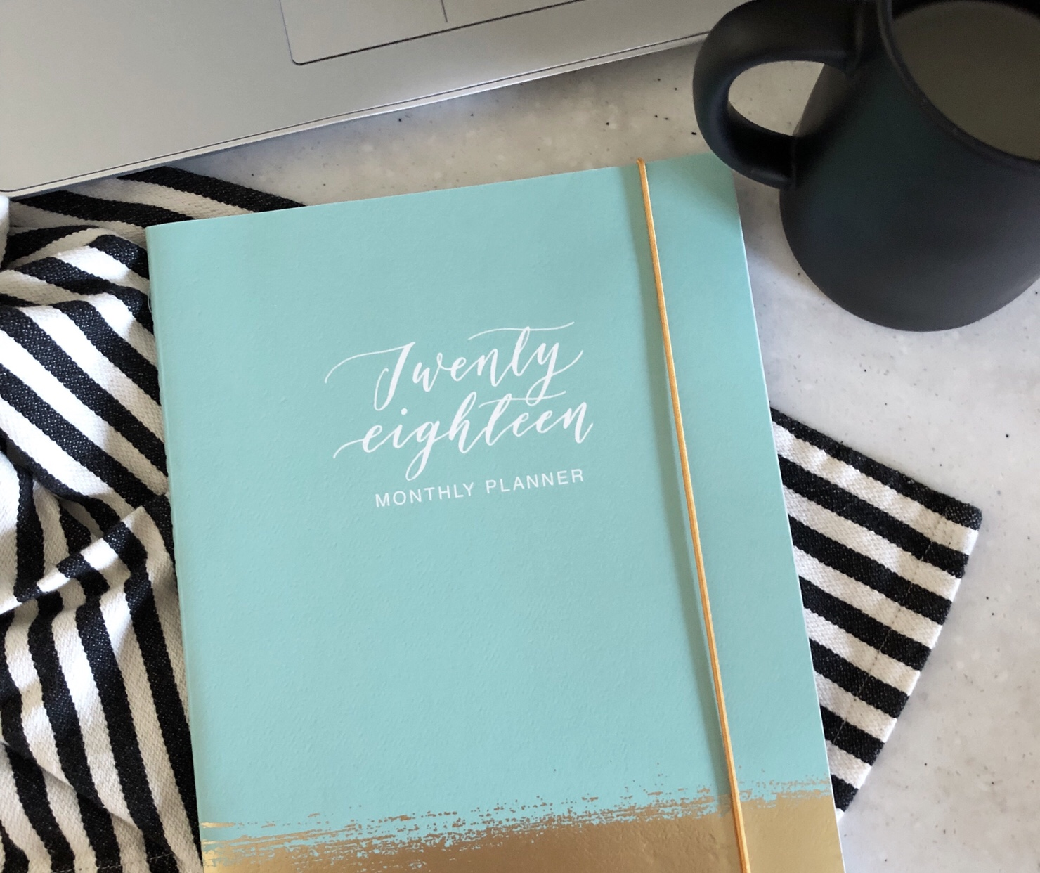 photo of a 2018 planner and coffee cup
