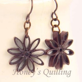 nine pointed star earrings - brown