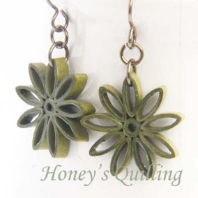 nine pointed star earrings - leaf green