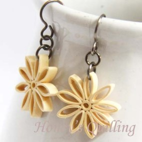 nine pointed star earrings - ivory