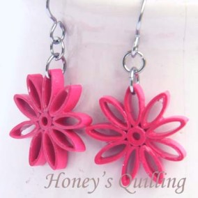 nine pointed star earrings - magenta