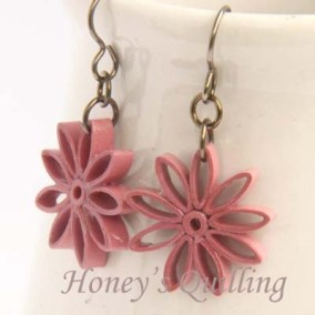 nine pointed star earrings - mauve