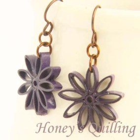 nine pointed star earrings - dark purple