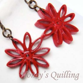 nine pointed star earrings - dark red
