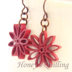 nine pointed star earrings - maroon