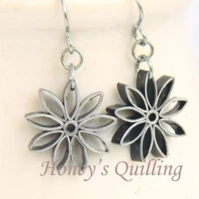 nine pointed star earrings - black with silver edge