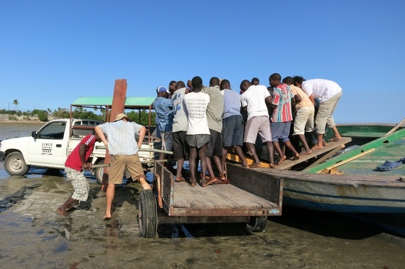 Moving equipment with a dhow boat in Mozambique