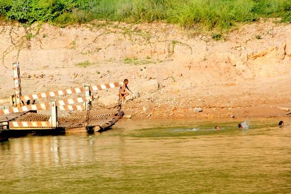 Kids Swimming in Laos