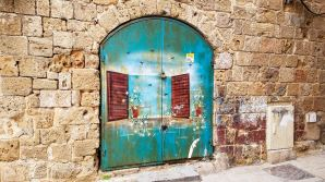 Most doors are turquoise in the old city and often have cheery street art like this.