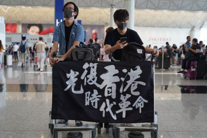 August 12 extradition protester eye protest