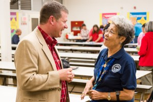 Nancy Woltmon speaks to Dr. Cameron during the refreshment break.
