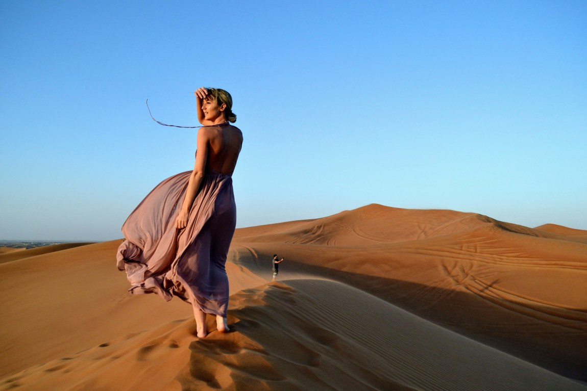 hoodiexo wearing a dress in the Dubai desert