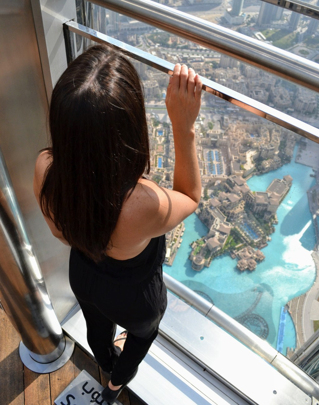 A girl looking at the view from At the Top Burj Khalifa in Dubai