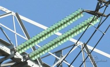 Begeerlijk groene glaskap-isolators