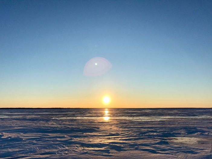 Cold sunset New Year's Eve on Lake Athapapuskow, Manitoba.