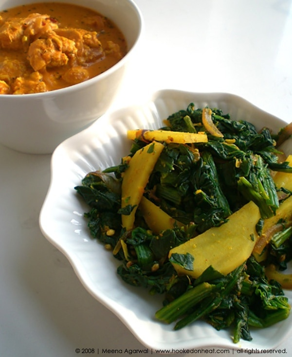Recipe for Alu Palak (Sauteed Spinach with Potatoes) taken from www.hookedonheat.com. Visit site for detailed recipe.