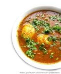 Recipe for Simple Egg Curry, taken from www.hookedonheat.com. Visit site for detailed recipe.