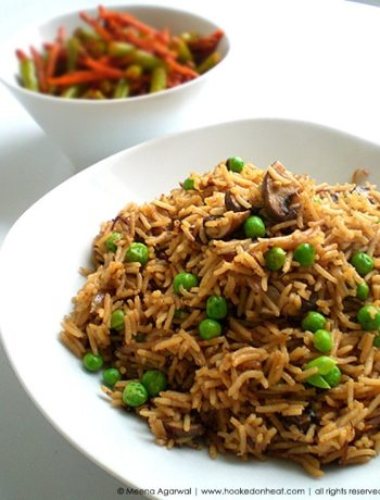 Recipe for Mushroom & Peas Pulao taken from www.hookedonheat.com. Visit site for detailed recipe.