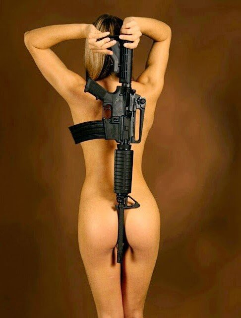 blonde naked gal with rifle