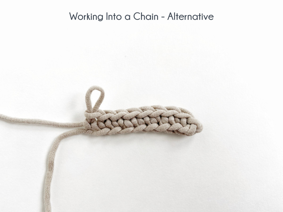 """""""Working into a chain - Alternative"""" A row of single crochet has been worked into the back bumps of all chain stitches and lays on a white background."""