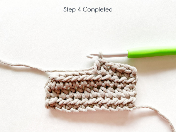 """""""Step 4 Completed"""" Photo shows the 5th half double crochet stitch of the 4th row in a taupe swatch completed."""