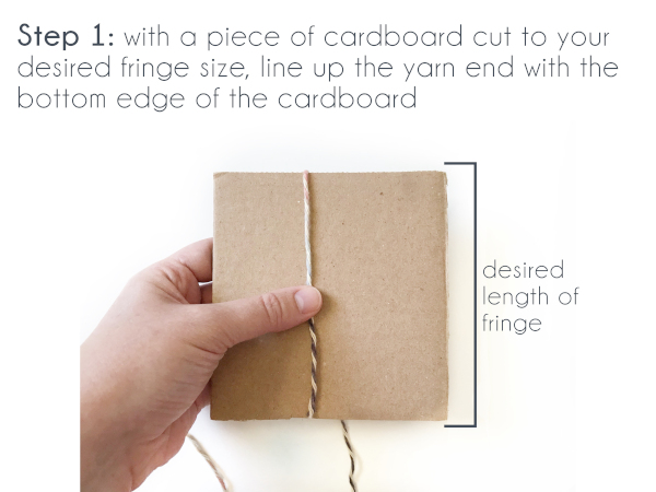 Text: Step 1: With a piece of cardboard cut to your desired fringe size, line up the yarn end with the bottom edge of the cardboard.