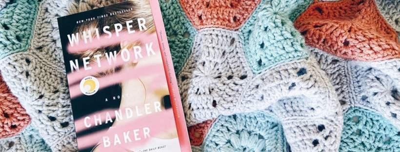 "A paperback copy of the book ""The Whisper Network"" by Chandler Baker lays on top of a colorful salmon, gray, teal and aqua crochet throw blanket."
