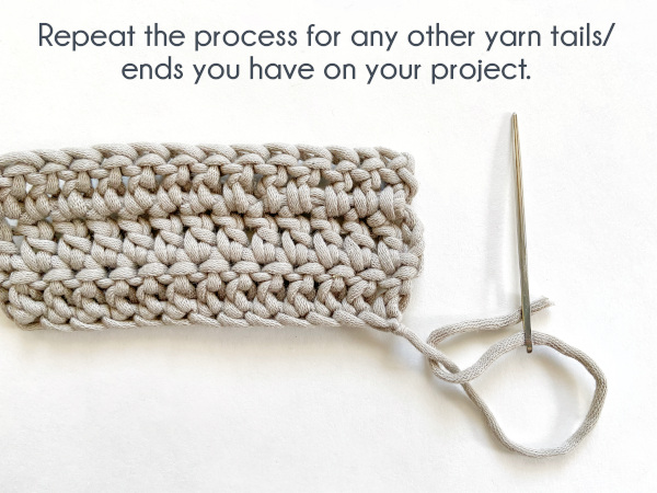 """Image shows the needle threaded with the beginning yarn tail. Text reads: """"Repeat the process for any other yarn tails/ends you have on your project."""""""