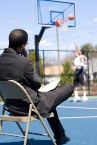 basketball coach in chair