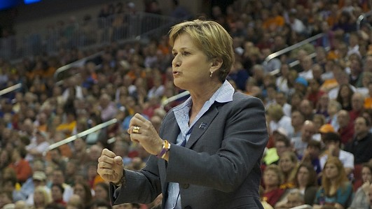 Pat Summitt hands the whistle to Holly Warlick
