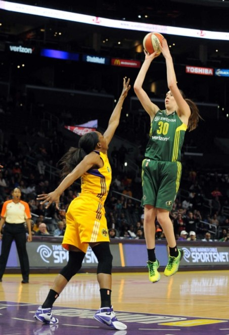 Seattle's Breanna Stewart skies to shoot over L.A.'s Nneka Ogwumike. Photo © Lee Michaelson, all rights reserved.