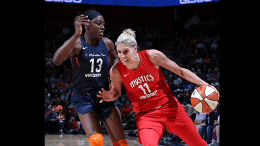 WASHINGTON, D.C. (June 26, 2018) - Elena Delle Donne dribbles past Chiney Ogwumike. Photo: NBAE/Getty Images.