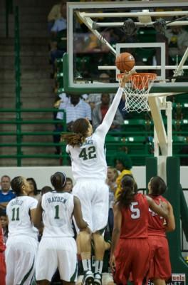 Brittney Griner (42) of Baylor finger rolls a basket against Lamar. Kimetria Hayden (1) and Mariah Chandler (11) watch.
