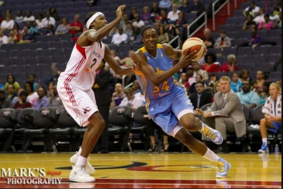 Chicago Sky center Sylvia Fowles (34) drives to the basket on Washington Mystics center Michelle Snow (2) during the first half of this WNBA game between the Mystics and the Sky at the Verizon Center in Washington, DC. May 19, 2012 (Photo: Mark W. Sutton)