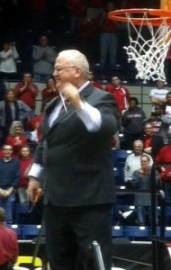 Marist coach Brian Giorgis cutting down the net.