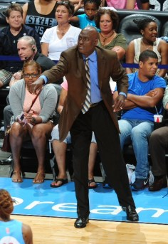 Head Coach Michael Cooper of the Atlanta Dream calls a play against the Chicago Sky on June 7, 2014 at Philips Arena in Atlanta, Georgia.   Photo: Scott Cunningham/NBAE.