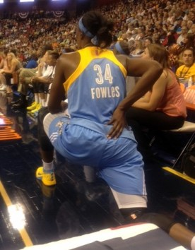 Sylvia Fowles stretching on the sideline.