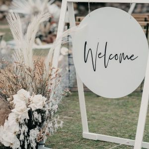White Round Welcome Sign