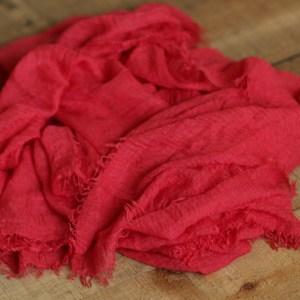 Hooriyah Collection's Prmium Cotton Crush Red wrap has raw frayed edges