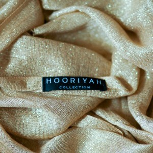 Hooriyah Collection's Tessori collection Dull Gold color Wrap is viscose shimmer glitter hijab